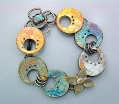 Featured Artist TEMI: A gorgeous sterling silver bracelet with a plethora of oxidized and 22 karat gold patinas. This bracelet also has a unique flower clasp with a set of colorful boulder opal.