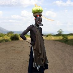 Woman from Mursi tribe with lip plate, Ethiopia Mursi Tribe, Rich Image, Music Licensing, Photo Library, Ethiopia, Royalty Free Photos, Africa, Plate, Portraits