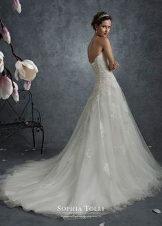 Sophia Tolli Y21759 Libra - Strapless tulle A-line gown with beaded appliqués. Misty tulle gown adorned with sequin beaded lace appliqués with metallic detailing, scalloped deep sweetheart neckline with illusion modesty panel, dropped waist, back corset, chapel length train. Removable spaghetti and halter straps included.  Also available with back zipper and diamante buttons as Y21759ZB.