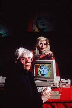 Andy Warhol paints Debbie Harry on an Amiga at the Commodore Amiga product launch press conference in 1985.