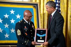 Command Sergeant Major Louis Wilson accepts the Medal of Honor from President Barack Obama awarded posthumously to Army Private Henry Johnson for conspicuous gallantry during World War I, at a ceremony in the East Room of the White House, June 2, 2015.
