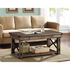 The Altra Wildwood coffee table will bring a touch of warmth and charm to your living space. It features a beautiful rustic finish with a beautiful grey undertone.
