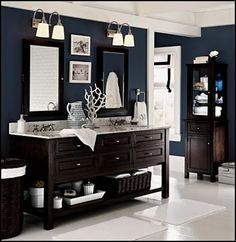 I love that dark blue wall color with the dark wood