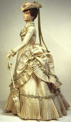 1870s. I think a reproduction of this would make a wonderful wedding gown for a historically minded bride
