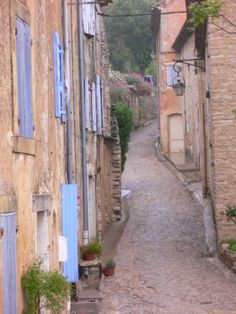 """A typical """"street"""" in the hill town of Gordes in Provence, France.  Yes, only one car fits!"""