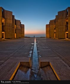 "Courtyard of the Salk Institute in La Jolla, California. Designed in 1965 by Louis Kahn. Reportedly, the concept of this open, contemplative space ""flowing"" into the Pacific ocean, was conceived in many long and inspiring conversations between Kahn and the founder of the Institute, the inventor of the polio vaccine, Jonas Salk. Photo ""Salk 