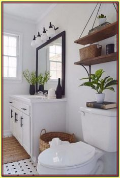 Modern bathroom decor ideas black and white bathroom with wood accent modern farmhouse decor delightfully chic . Diy Bathroom Decor, Bathroom Interior, Budget Bathroom, Bathroom Ideas, White Bathroom, Bathroom Remodeling, Bathroom Lighting, Remodeling Ideas, Simple Bathroom