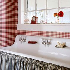 Ticked Off - Blue-and-white ticking makes a great skirt for a vintage kitchen sink that has been repurposed in the bathroom. Store toiletries and bathroom necessities behind the skirt.
