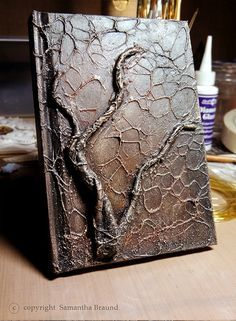 This time I used some very inexpensive craft brass wire, and sculpted armatures out of it. Then using masking tape and arcylic paints I managed to create the look I was after...the uni course had really helped me in this area - last term I was constantly using aluminium wire and newspaper to create built up mixed media paintings. ...but this is the first time I was able to make something like this on a book cover.