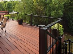 Horizon composite decking and railing, shown in Rosewood decking and Mission profile in black with metal balusters