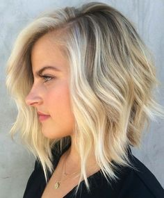 Medium hairstyles - mid length textured bob with hidden layers and center part.