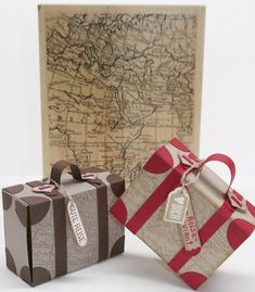 "ein Koffer mit Reiseproviant als Geschenkverpackung Suitcase for travel provisions with the background stamp ""World Map"" Stampin Up, Stamp World, Surprises For Her, Diy And Crafts, Paper Crafts, Envelope Punch Board, Travel Party, Exploding Boxes, Explosion Box"