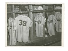 Here is one last item from the current Lelands Auction that I thought was worth mentioning.  Featured above is a vintage photograph of the empty stalls within the Dodgers clubhouse.  As you can see, Roy Campanella's uniform is prominently displayed among throngs of Dodger flannels on wire hangers.