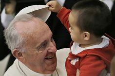The Pope Francisco plays with a child during a hearing in Santa Marta residence. (REUTER)