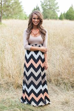 This floor length maxi features a solid colored neutral top with fun multi colored chevron stripes on the bottom. Comfortable and cute, this dress is a must, and can be dressed up or down.