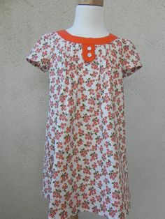 http://www.etsy.com/listing/91333978/girls-dress-by-oliver-s