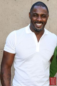 Idris Elba at the Palm Springs Film Festival   polo shirt and a pair of faded jeans.