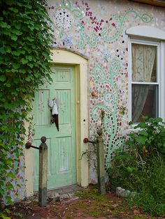 Mosaic wall and doorway.would be lovely on the walled garden area.