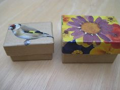 Tiny boxes decorated with magazine pictures cut out and stuck on then varnished.