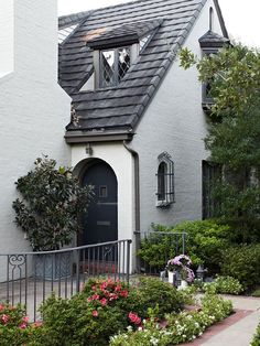 A Secret Door Tucked away, this storybook front door best demonstrates how to create a sense of adventure and discovery. A rich blue accents the curved door head, an often-seen element in whimsical home architecture. Details, including an extra-long hing Cute Cottage, Cottage Style, Cottage Homes, Exterior Paint, Exterior Design, D House, House Colors, Curb Appeal, My Dream Home