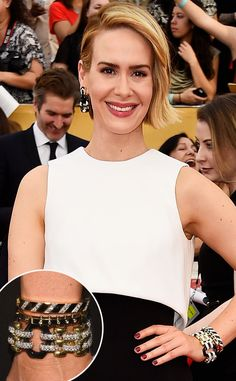 Sarah Paulson embracing the bold wrist with David Webb's Night and Day #Bracelet (made of carved black onyx links, brilliant-cut diamonds, 18-carat gold and platinum) and two bangles made with black enamel, brilliant-cut #diamonds, 18-carat gold and platinum that she sported with her Black and White Valentino at the SAG Awards.