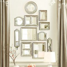 This dramatic mirror collection creates an instant gallery look with timeless Suzanne Kasler style. Each mirrored piece is hand crafted of pine with aged silver finish and rubbed black edge to accentuate the shape.