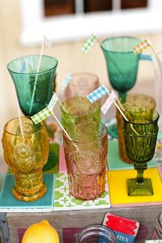 Love the idea of getting an eclectic bunch of glasses for the wedding reception and having the guests take them home as favors.
