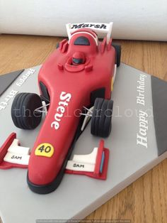 A formula one racing car birthday cake. Car Birthday, August Birthday, First Birthday Cakes, 1st Birthday Parties, Car Cake Tutorial, Race Car Party, Biscuit, Homemade Cakes, Celebration Cakes