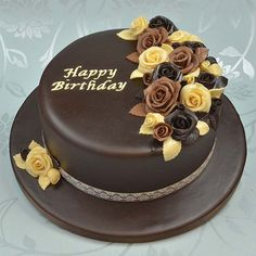 Cake covered with Satin Ice chocolate fondant and modeling chocolate roses. Love it!