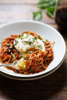 This Spaghetti Marinara with Poached Eggs uses simple ingredients to make a deliciously comforting meal from scratch that comes together in just 20 minutes. #vegetarian #sugarfree #pasta #recipe | pinchofyum.com