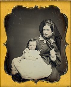Victorian beauty with baby. daguerreotype of beautiful Victorian mother and her daughter or son. Excellent depth contrast and reflective quality. It looks like her ribbon is blowing in the wind. once again the soft focus adds to the beauty of this image. Antique Photos, Vintage Pictures, Old Pictures, Vintage Images, Old Photos, Group Pictures, Baby Pictures, Louis Daguerre, Memento Mori