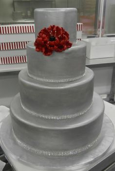 Metallic wedding cake with a pop of red