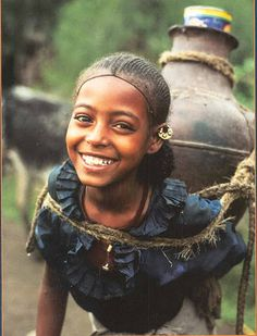 Ethiopia. She carries a heavy load, but look at that smile! Just so happy.