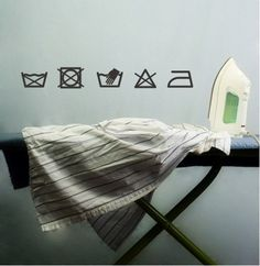 Set of Five Laundry Room Symbols Vinyl by madebytheresarenee. , via Etsy.