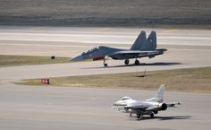 A USAF F-16 prepares for take-off as a Indian Air Force Su-30MKI queues up for its turn during Red Flag 2016 in Alaska.