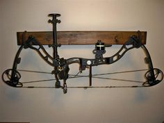 display compound bow on wall - Google Search