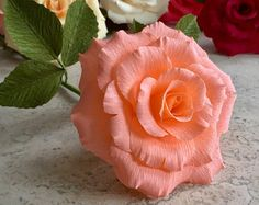 This single stem coral charm peony is highly detailed and realistic. Beautiful on its own or in an arrangement, they are sure to add an elegant feel to your home decor, at your wedding, or anywhere you care to enjoy it. Made with extra-fine German crepe paper to accentuate the organic look, this beautiful peony will never wilt or die.  All blooms are approximately 7 in diameter and are on 18 wire stems. The stems can be cut or bent to fit in any vase you desire. The price of shipping is…