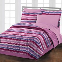 @Overstock.com - Brighten up your bedroom with this contemporary striped comforter set. This four-piece set features a striking pattern in shades of pink, blue, and burgundy that's easy to match to any decor. The set includes a sham and a bed skirt for a completed look.http://www.overstock.com/Bedding-Bath/Blackberry-Chevron-4-piece-Comforter-Set-with-Bedskirt/6761956/product.html?CID=214117 $61.99