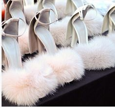 These remind me of Elle Wood's shoes from her bunny costume!