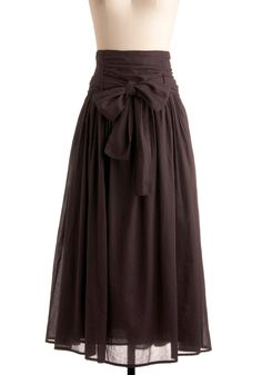 In Tandem Midi Skirt in Charcoal... I just love it! Cute accent bow, great color for accessorizing (with something rust colored or teal?) Great length, too.