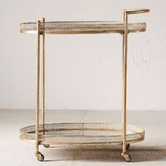 Rebecca mirrored bar cart: Metal bar car in a modern design with 2 glass top surface areas for storing bottles + making drinks. Perfect for pre-ceremony drinks, escort cards, favors, or as a sweets display.