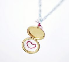 DIY Embroidered Heart Locket. Tutorial and links to an Etsy supplier of lockets (huge assortment) from Wild Olive here.*Other examples shown and links given.