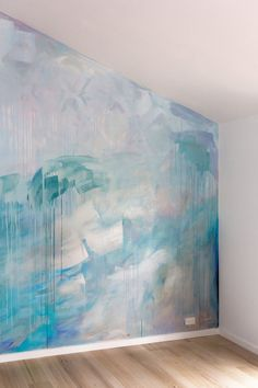Artist Camille Javal detail of contemporary abstract ocean water mural in pastel blue, green and metallic paint, featuring a wave, drips and geometric shapes, the artwork has movement and reflects light in the living room. Drip Painting, Mural Painting, Pintura Patina, Wall Colors, Paint Colors, Wall Murals, Wall Art, Bleu Pastel, Watercolor Walls