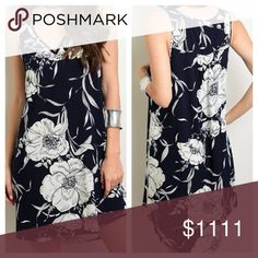 """New- Floral Shift Mini Dress Navy Sleeves large floral print dress. 100% Rayon. Sleeves large floral print dress. 100% Rayon. Medium- full length back 35.4"""", front 33.4"""", underarm to underarm 19"""", W:21"""". Large -full length back 36"""", front 33.8"""", underarm to underarm 21"""", W:22"""". No under lining. Can be worn with leggings. Please ask questions if you are not sure Dresses Mini"""