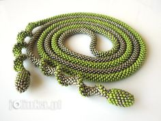"Jolinka.  Bead crochet rope with a peyote spiral and ""olive"" bead finish to rope ends."