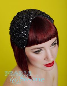 Jet – Black Jewel Vintage Inspired Headpiece  Sparkly glitter and gem covered headpiece set on a wired sinamay base backed with leopard print satin. Attaches with a comb and hat elastic, this can be worn more on one side or the order or centrally. Perfect for #Hollywood #starlets, #vintage #lovers or any #glamourous #event! http://www.pearlsandswine.com