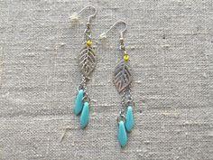 Earrings / Øreringe. Blue long dangle earrings made of steel and glass. www.bulowssmykker55.amioamio.com