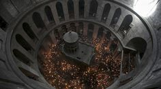 File photo - Worshippers hold candles as they take part in the Christian Orthodox Holy Fire ceremony at the Church of the Holy Sepulchre in Jerusalem's Old City April (REUTERS/Baz Ratner) Christ Tomb, Jesus Christ, Roman Era, Photo Candles, Image Of The Day, Pictures Of The Week, Christianity, First Time, April 11