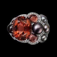 """Cartier. """"Automne"""" Ring - white gold, one 12.77-carat cushion-shaped brown orange tourmaline, four button-shaped gray natural pearls totaling 19.12 grains, three round-shaped cabochon-cut pinkish brown garnets totaling 4.09 carats, round-shaped cabochon-cut orange sapphires, brilliant-cut diamonds. Cartier Jewelry, Cartier Rings, Lotus Jewelry, Tourmaline Jewelry, Orange Sapphire, High Jewelry, Diamond Are A Girls Best Friend, White Gold Rings, Jewerly"""