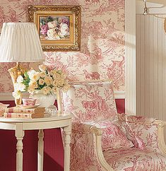 Love red toile on wall & chair with ivory painted moldings & table.